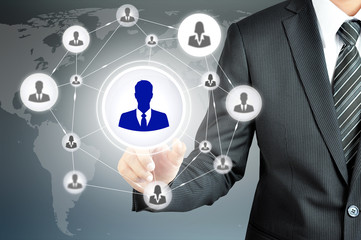 Hand pointing to businessman icon in the middle that linked with
