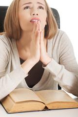 Woman praying to pass the exam