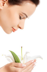 Young woman smelling white lily