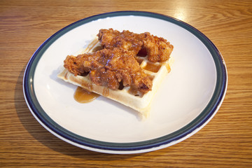 Chicken and waffles covered with a maple bourbon sauce.