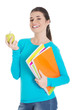 Happy woman holding an apple and notebooks