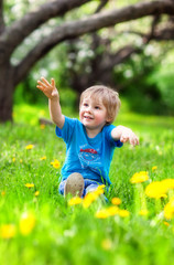 Boy in a lush garden
