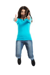 Young happy woman jumping with thumbs up