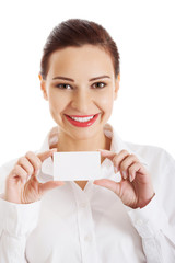Portrait of woman with business card