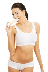 Attractive woman eating a banana