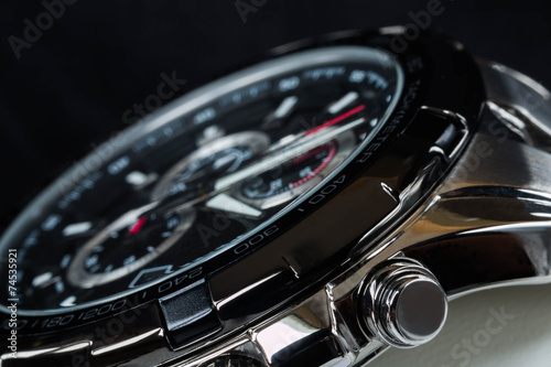 luxury man watch detail, chronograph close up - 74535921