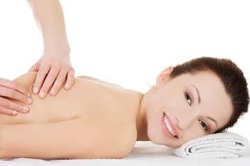Woman relaxing in spa by getting massage