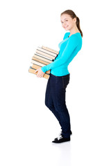 Young student holding heavy books