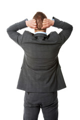Back view businessman putting hands on the nape
