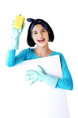 Portrait of a woman with sponge and empty banner