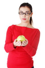 Portrait of beautiful woman with an apple