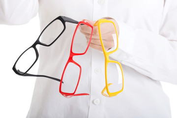 Woman holding group of eyeglasses