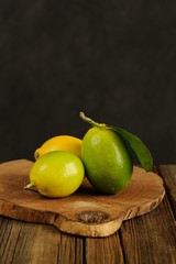 Limes and lemons on wooden board