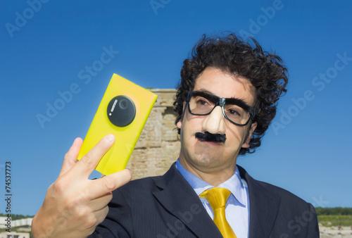 crazy masked man funny selfie portrait - 74537773