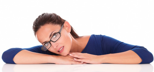 Beautiful latin female with glasses looking at you