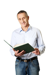 Handsome man reading his schedule
