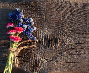 pink and blue bouquet on wooden background