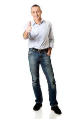 Full length mature man gesturing ok sign
