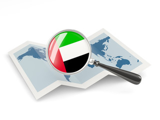 Magnified flag of united arab emirates with map