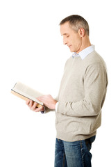 Side view mature man reading a book