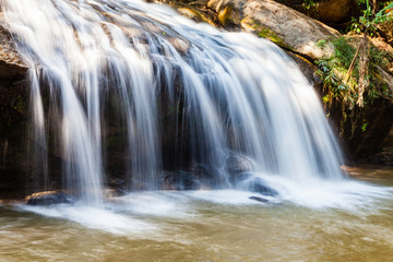 Scenic waterfall flowing on stone at Mae Sa waterfall Doi Suthep