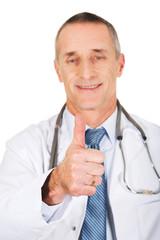 Portrait of confident male doctor with thumb up
