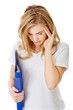 Woman with headache holding a binder