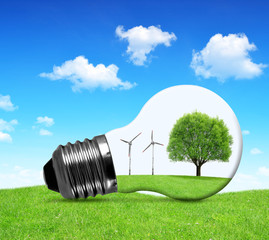 Eco bulb with wind turbines and tree