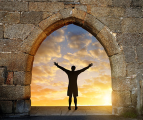 Man standing in front of the gate to heaven.