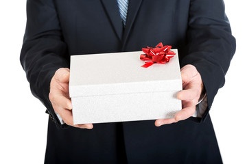 Close up on a male hands holding christmas gift