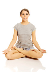 Woman relaxing by yoga