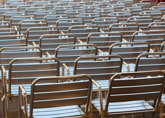 Empty metal seats places in public space
