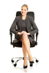 Businesswoman sitting on armchair