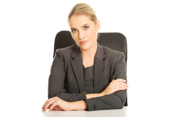 Smiling businesswoman sitting at the desk