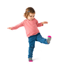 Little girl walking over white background