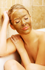 Woman with chocolate mask based on a bath by elbow