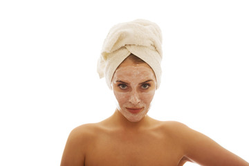 Portrait of a confident woman with face cream