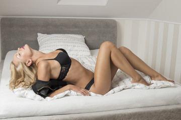 girl with erotic lingerie on bed