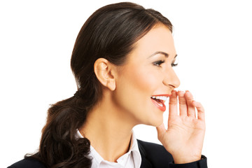 Portrait of businesswoman whispering to someone