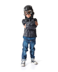Kid dressed as aviator with his arms crossed