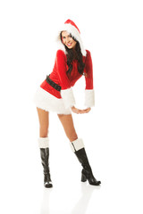 Attractive santa woman standing astride and inclined