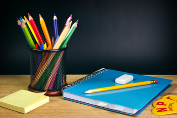 Teacher's desk with a color pencil, notebook