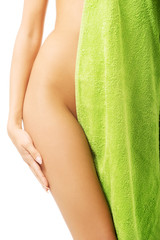 Close up on female body wrapped in towel