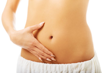 Woman touching her slim belly