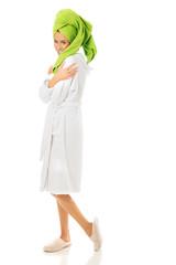 Full length woman wearing a bathrobe