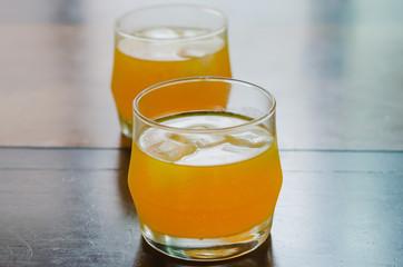 close up of orange juice with ice