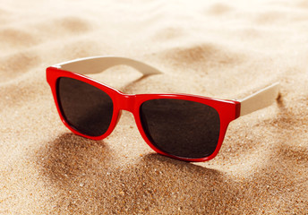 Sunglasses on a sandy beach