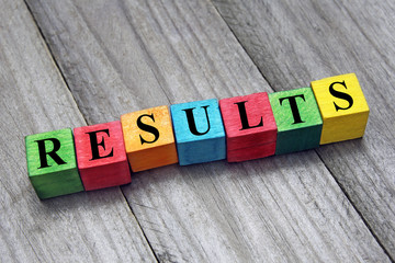 concept of results word on wooden cubes