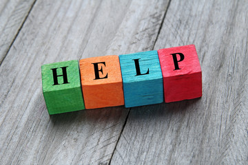 concept of help on colorful wooden cubes