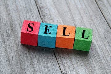 sell concept on colorful wooden cubes